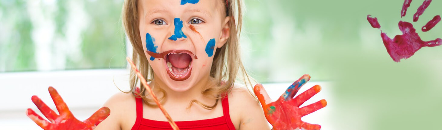 excited little girl with paint on her hands